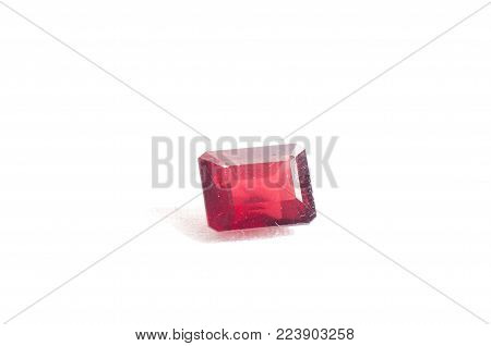 ruby red garnet jewel crystal on a white background