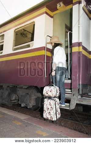 Pretty Asian Women Traveler Standing And Drag And Drop Luggage On The Train.
