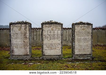Burghausen,Germany-Jan 26,2018: On the Holocaust meorial day headstones in english,hebrew and german in a cemetery on an outpost of the Dachau Concentration camp remember the jewish prisoners that died at the site.