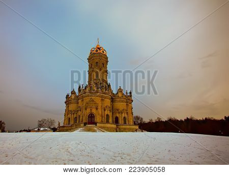 An unusual Christian church in the Moscow region. Church of Our Lady of the Sign (Znamenskaya church) in Dubrovitsy. Podolsk district. Russia Winter landscape.