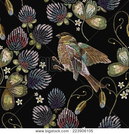 Embroidery titmouse and clover seamless pattern. Classical beautiful flowers clover. Fashionable template for design of clothes
