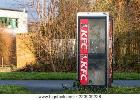 Northampton UK January 10 2018: KFC Kentucky Fried Chicken logo sign on phone booth.