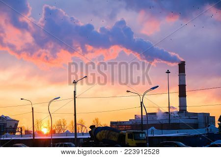 the thick smoke belching from factory chimneys