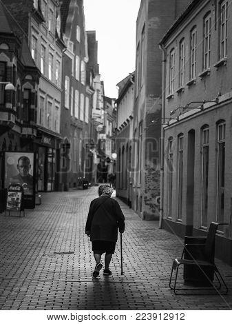 VIBORG, DENMARK -  AUGUST 09, 2016: An unidentified woman walking on the street in Viborg, Denmark.