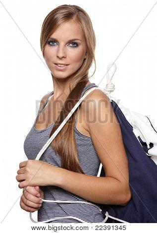 Beautiful sexy woman wearing sailor striped dress posing