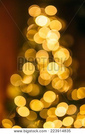 Bokeh of a Christmas tree in lovely home. Hollidays