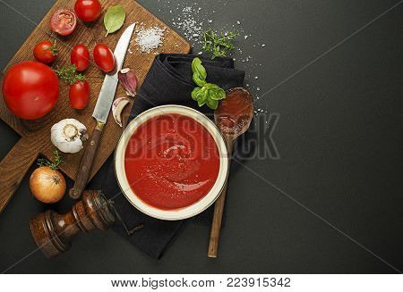 Fresh ingredients for cooking tomato sauce or soup on wooden background place for text. Vegan food vegetarian and healthy cooking concept.