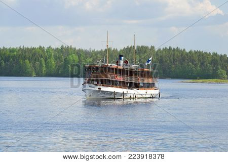SAIMAA LAKE, FINLAND - JUNE 17, 2017: Walk on the Saimaa lake by old steamship
