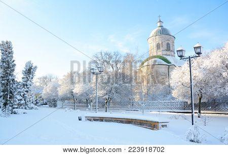 Old greek orthodox church of st john the theologian  coverd snow, sunrise light  in winter in Nizhyn, Ukraine.