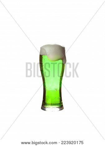 St. Patrick's Day. A glass of green beer on a white background. Oktoberfest. Glass of light beer isolated on white background