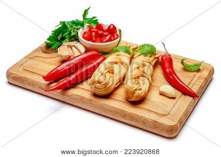 Smoked braided cheese and red pepper isolated on white background