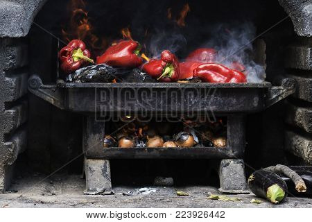 Grilled vegetables on a stone and metal grill