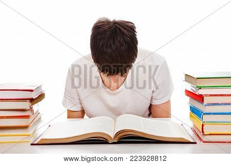 Tired Student at the Writing Table on the White Background