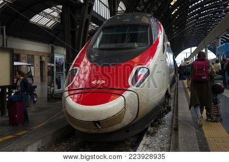 MILAN, ITALY - SEPTEMBER 18, 2017: High-speed train ETR 600 Frecciargento company of the Trenitalia close-up. Milano Railway Station