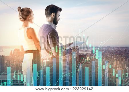 Side view of attractive young businesspeople with document standing on abstract city background with forex chart. Market and statistics concept. Double exposure