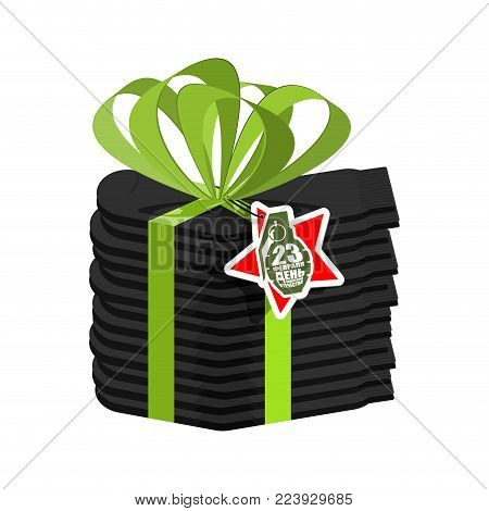 Stack of socks and ribbon. Traditional gift for men on February 23. Day of Defender of Fatherland in Russia. Translation text Russian. February 23.
