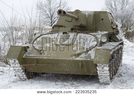 SAINT PETERSBURG, RUSSIA - JANUARY 14, 2018: SU-76 - the Soviet self-propelled artillery cannon of the period of World War II close up in the cloudy winter afternoon