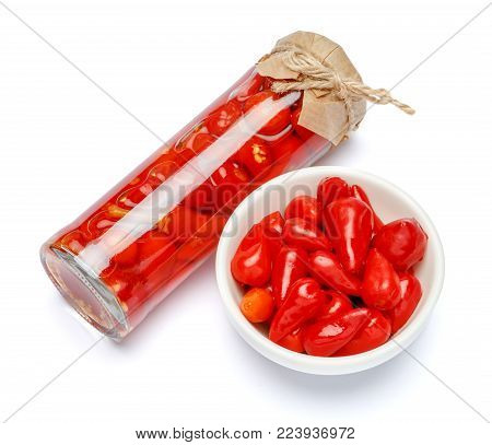 Canned vegetables - Marinated red pepper isolated on white background. Preserved red sweet chilli peppers