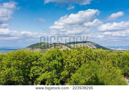 Hill, Palava Czech republic, forest hill and blue sky with white clouds