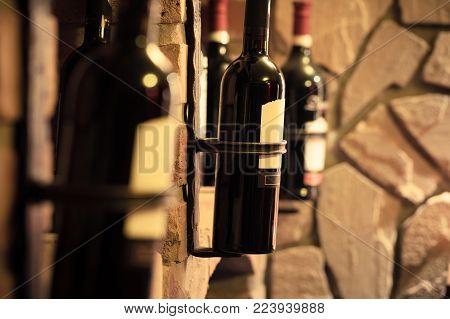 Wine bottles close up at the underground cellar