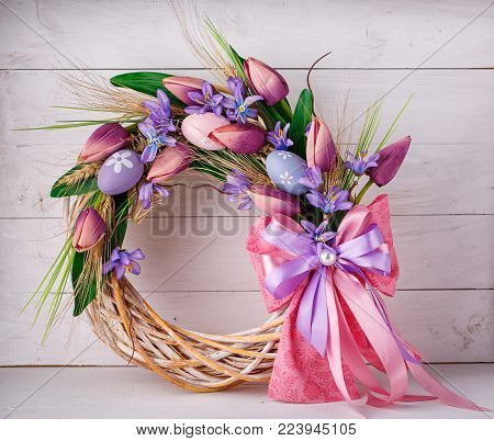 wreath decorated with flowers and Easter eggs. Easter decoration.