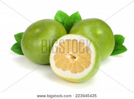 Citrus Sweetie or Pomelit, oroblanco with half and leaf isolated on white background close-up.