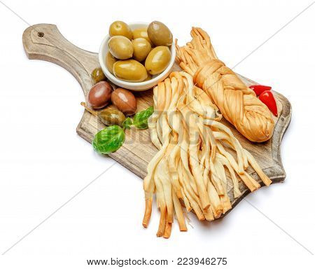 Smoked braided cheese and vegetables isolated on white background
