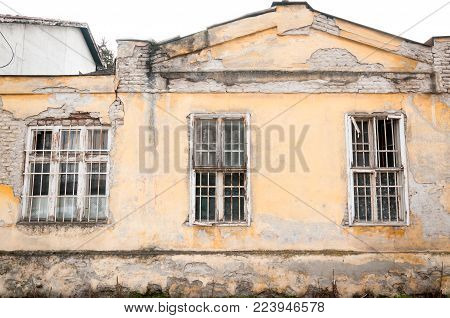 Old abandoned house with gratings on the windows used as police station and prison during world war two by Nazi Germans and Hungarians for civilians