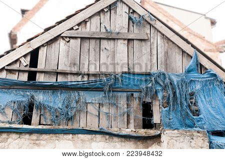 Wooden roof plates on the old abandoned house