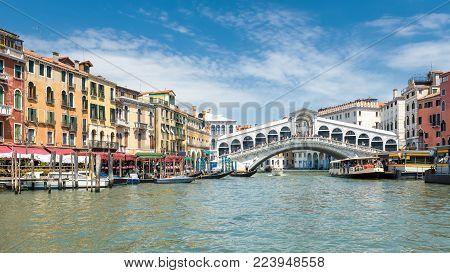Famous Rialto Bridge over the Grand Canal in Venice, Italy. Rialto Bridge (Ponte di Rialto) is one of the main tourist attractions of Venice.