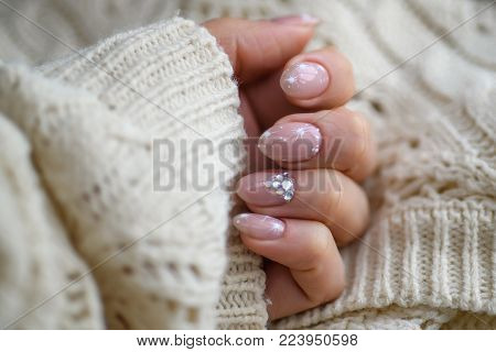 Nail Polish. Art Manicure. Modern style blue Nail Polish.Stylish pastel Color pink white Nails holding wool material sleeve blouse isolated white background wall. Classic wedding bride nails design.