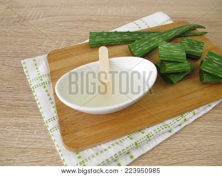 Aloe vera-leaves and aloe vera-gel in bowl