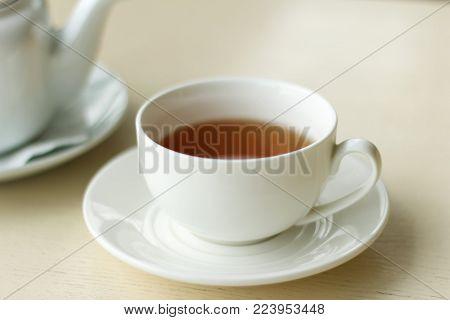 Tea time - white teacup and teapot