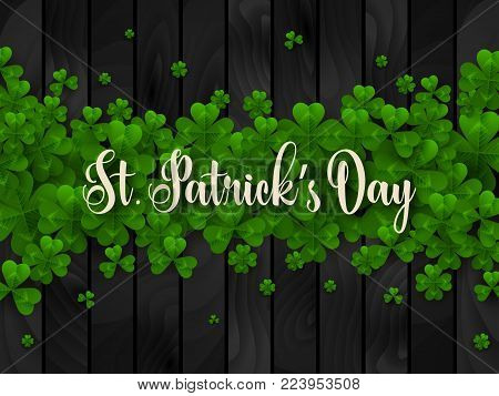 Saint Patrick's Day Border with Green Four and Tree Leaf Clovers on Black Wooden Background. Vector illustration. Party Invitation Design, Typographic Template. Lucky and success symbols