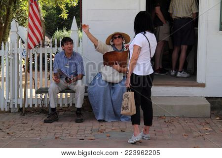 Williamsburg, Va - October 6: A Tourist In The Williamsburg Colonial District Pauses To Ask For Info