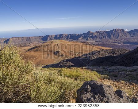 Desert Volcanic Landscape With Purple Mountains In El Teide National Nature Park With Huevos Del Tei