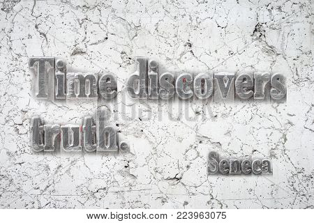 Time discovers truth - ancient Roman philosopher Seneca quote mounted on white marble wall
