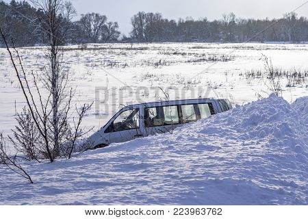 Car In Ditch After Winter Accident. Vehicle Loses Control And Drove Off Road At Ice.