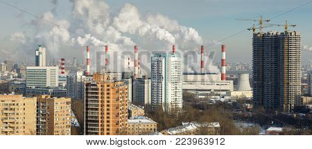 MOSCOW/ RUSSIA - JANUARY 25, 2017. Panoramic view of the Akademichesky district of Moscow with the smoking chimneys of the combined heat and power plant 20.