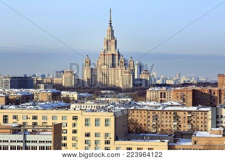 MOSCOW/ RUSSIA - JANUARY 25, 2017. Top view of the main building of Lomonosov Moscow State University, surrounded by the residential houses. Moscow, Russia.