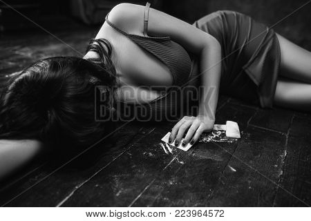 Woman in a drug rush. Blissful effects of cocaine. Extasy after doing a line concept. Social problems and addictions of wealthy youth.