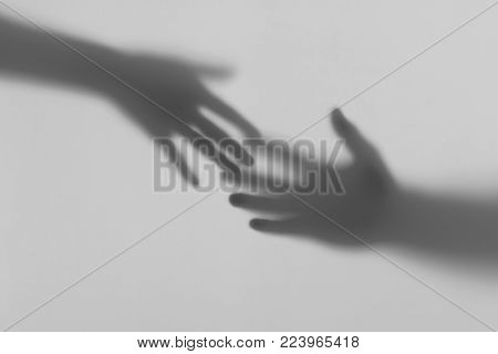 The male and female hand touch. Relationship between lovers