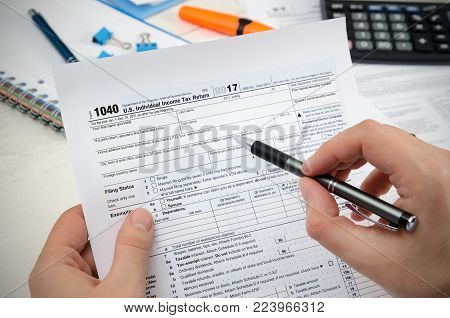 Man Filling Us Tax Form.