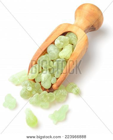 Royal Green Hojari Frankincense in the wooden spoon, isolated on the white background