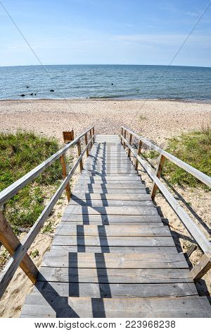 Beautiful Summer View Of The Baltic Sea,  Sandy Beach,  Trail Of Wooden Planks And Bright Blue Sky,