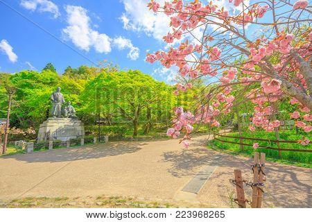 Statue of Sakamoto Ryoma and Nakaoka Shintaro at Maruyama Park, spring season with cherry blossom in Kyoto, Japan. Maruyama Park is Kyoto's most famous cherry-blossom viewing hanami spot.