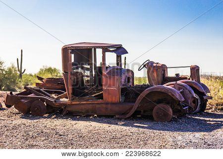 Retro Rusted Shells Of Automobiles In Arizona Desert