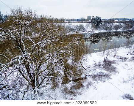 Vilnius, Lithuania: aerial top view of ice drift in Neris river in winter
