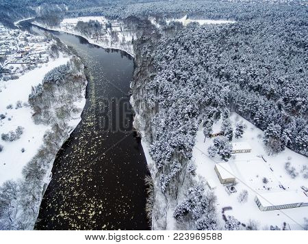 Vilnius, Lithuania: aerial top view of Neris river and Vingis park in beautiful colors of winter