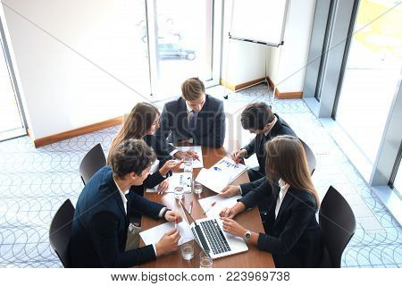 Business meeting in an office, the businesspeople are discussing a document